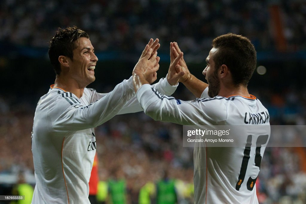 <a gi-track='captionPersonalityLinkClicked' href=/galleries/search?phrase=Cristiano+Ronaldo+-+Soccer+Player&family=editorial&specificpeople=162689 ng-click='$event.stopPropagation()'>Cristiano Ronaldo</a> (L) of Real Madrid CF celebrates with team-mate Daniel Carvajal after scoring their opening goal during the UEFA Champions League group B match between Real Madrid CF and FC Copenhagen at Estadio Santiago Bernabeu on October 2, 2013 in Madrid, Spain.