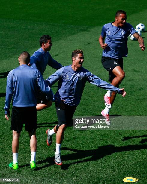 Cristiano Ronaldo of Real Madrid CF celebrates with teammates Danilo Luiz da Silva Karim Benzema and James Rodriguez druing a training session ahead...