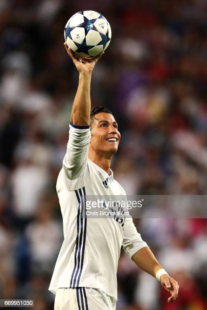 Cristiano Ronaldo of Real Madrid CF celebrates with the match ball following the UEFA Champions League Quarter Final second leg match between Real...