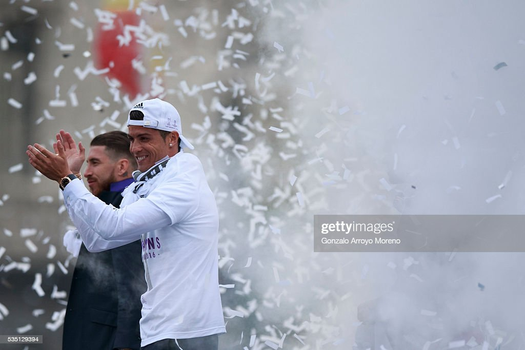 Cristiano Ronaldo (R) of Real Madrid CF claps ahead his teammate Sergio Ramos (L) during their team celebration at Cibeles square after winning the Uefa Champions League Final match agains Club Atletico de Madrid on May 29, 2016 in Madrid, Spain.