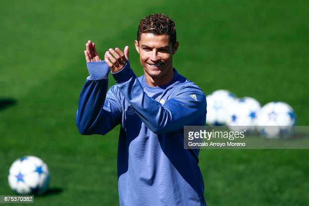 Cristiano Ronaldo of Real Madrid CF claps druing a training session ahead of the UEFA Champions League Semifinal First leg match between Real Madrid...
