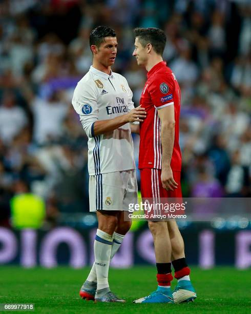 Cristiano Ronaldo of Real Madrid CF clashes hands with Robert Lewandowski of Bayern Muenchen after the UEFA Champions League Quarter Final second leg...