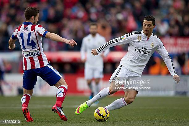 Cristiano Ronaldo of Real Madrid CF competes for the ball with Gabi Fernandez of Atletico de Madrid during the La Liga match between Club Atletico de...
