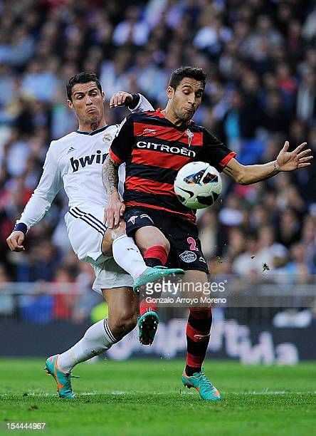 Cristiano Ronaldo of Real Madrid CF competes for the ball with Hugo Mallo of RC Celta de Vigo during the La Liga match between Real Madrid CF and RC...