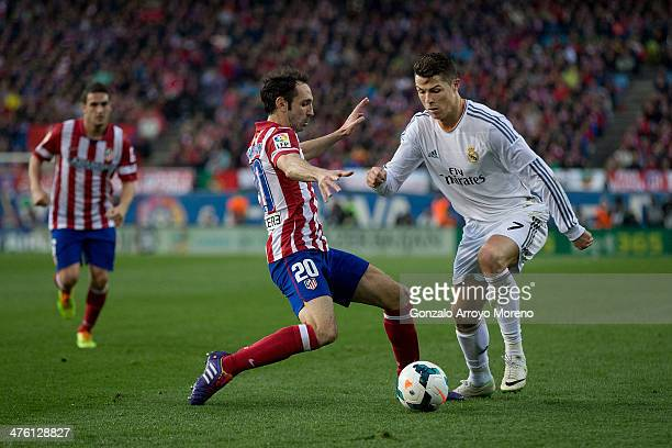 Cristiano Ronaldo of Real Madrid CF competes for the ball with Juan Francisco Torres alias Juanfran of Atletico de Madrid during the La Liga match...