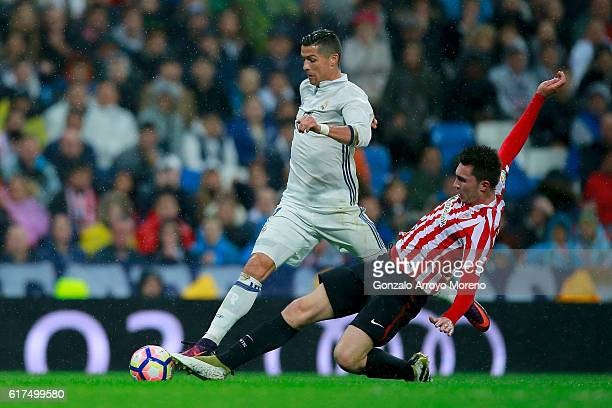 Cristiano Ronaldo of Real Madrid CF competes for the ball with Aymeric Laporte of Athletic Club during the La Liga match between Real Madrid CF and...