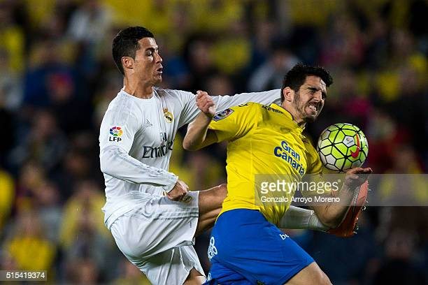 Cristiano Ronaldo of Real Madrid CF competes for the ball with Pedro Bigas of UD Las Palmas during the La Liga match between UD Las Palmas and Real...