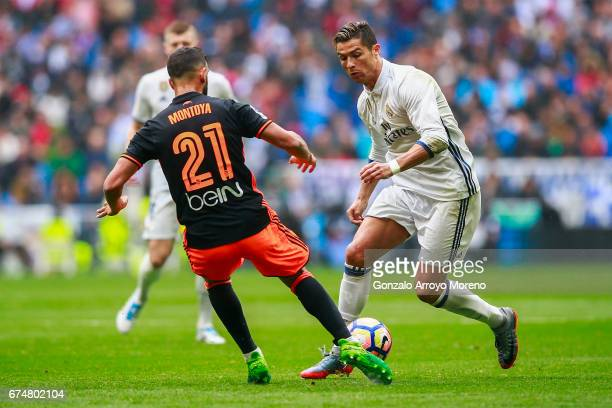Cristiano Ronaldo of Real Madrid CF competes for the ball with Santi Mina of Valencia CF during the La Liga match between Real Madrid CF and Valencia...