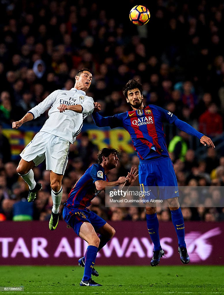 Cristiano Ronaldo of Real Madrid CF competes for the ball with Sergio Roberto of FC Barcelona and Andre Gomes of FC Barcelona during La Liga match...
