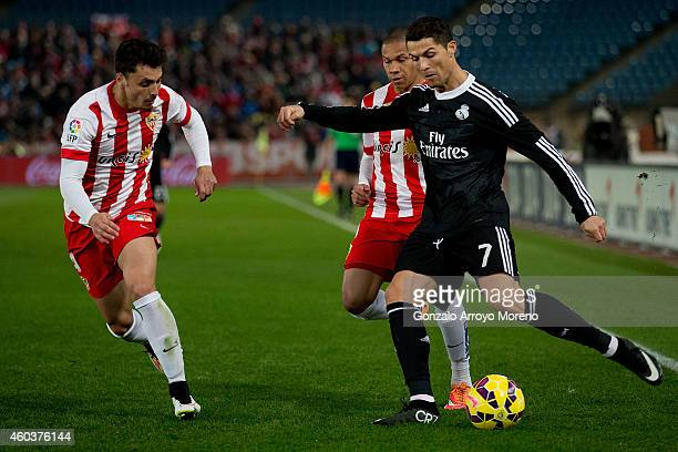 Cristiano Ronaldo of Real Madrid CF competes for the ball with Wellington Silva of Almeria UD with teammate Joaquin Navarro JImenez during the La...