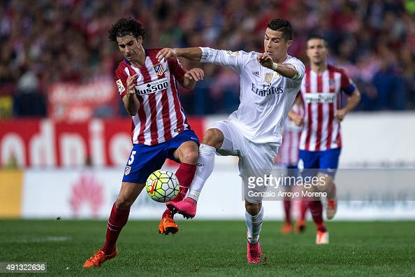 Cristiano Ronaldo of Real Madrid CF competes for the ball with Tiago Mendes of Atletico de Madrid during the La Liga match between Club Atletico de...