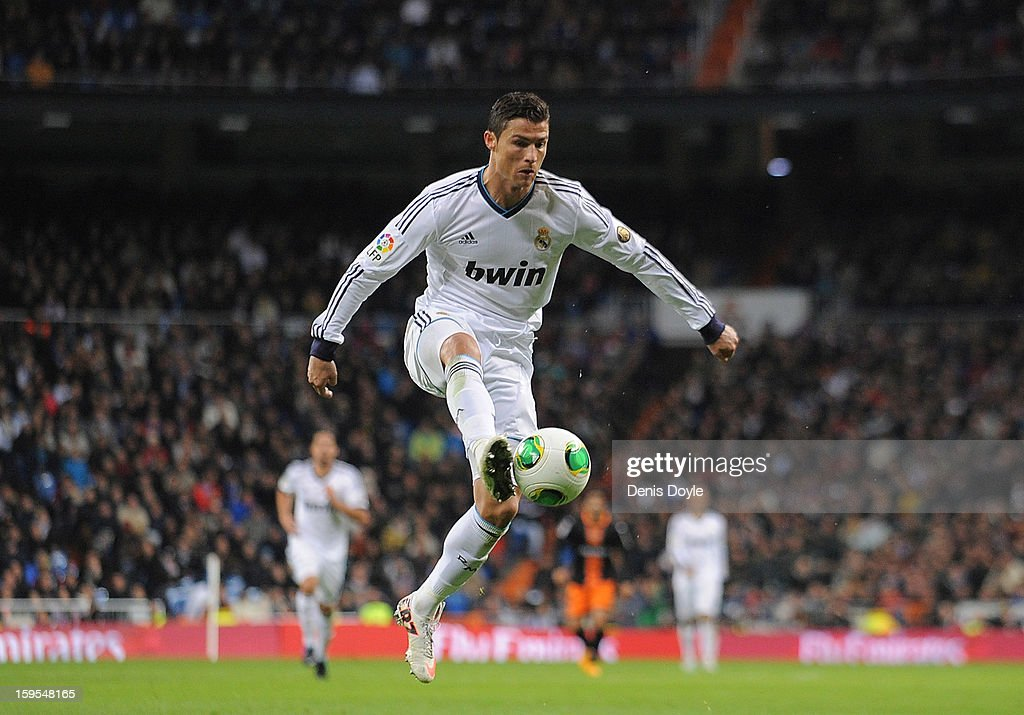 <a gi-track='captionPersonalityLinkClicked' href=/galleries/search?phrase=Cristiano+Ronaldo+-+Soccer+Player&family=editorial&specificpeople=162689 ng-click='$event.stopPropagation()'>Cristiano Ronaldo</a> of Real Madrid CF controls the ball during the Copa del Rey Quarter Final, 1st leg match between Real Madrid CF and Valencia CF at Estadio Santiago Bernabeu on January 15, 2013 in Madrid, Spain.