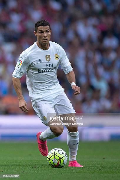 Cristiano Ronaldo of Real Madrid CF controls the ball during the La Liga match between Real Madrid CF and Malaga CF at Estadio Santiago Bernabeu on...