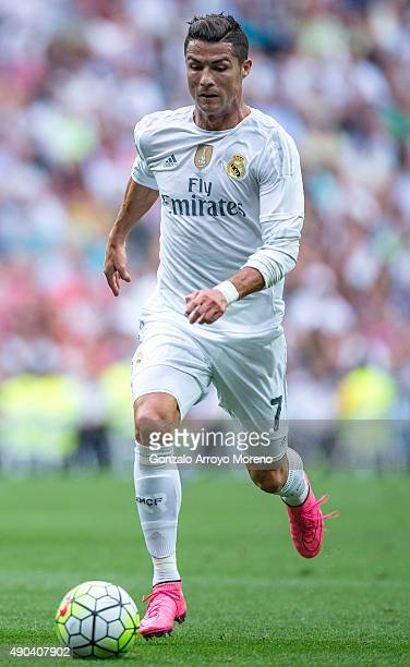 Cristiano Ronaldo of Real Madrid CF controls the ball during the La Liga match between Real Madrid CF and Malaga CF at Estadio Santiago Bernabeu on...
