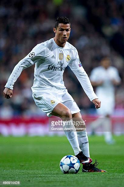 Cristiano Ronaldo of Real Madrid CF controls the ball during the UEFA Champions League Group A match between Real Madrid CF and Paris SaintGermain at...