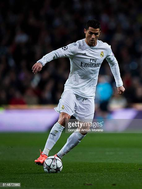 Cristiano Ronaldo of Real Madrid CF controls the ball during the UEFA Champions League Round of 16 Second Leg match between Real Madrid CF and AS...