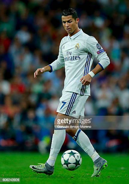 Cristiano Ronaldo of Real Madrid CF controls the ball during the UEFA Champions League group stage match between Real Madrid CF and Sporting Clube de...