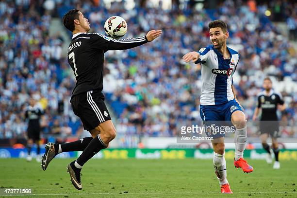 Cristiano Ronaldo of Real Madrid CF controls the ball next to Victor Alvarez of RCD Espanyol during the La Liga match between RCD Espanyol and Real...