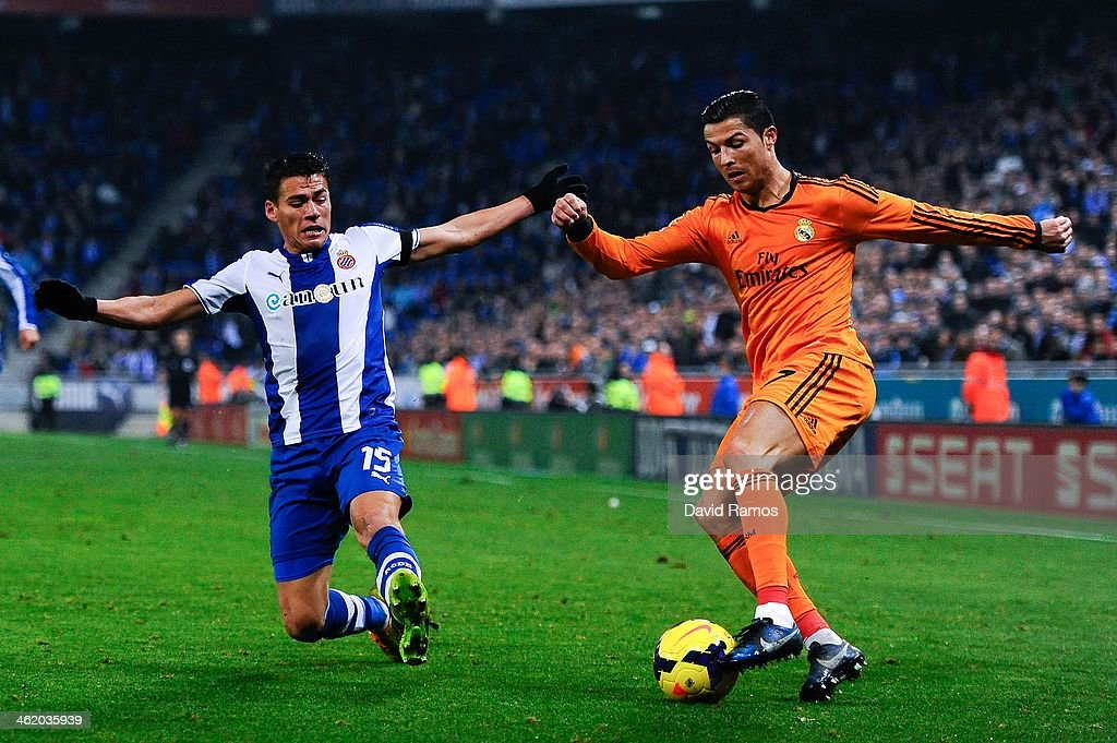 Cristiano Ronaldo of Real Madrid CF duels for the ball with Hector Moreno of RCD Espanyol during the La Liga match between RCD Espanyol and Real...