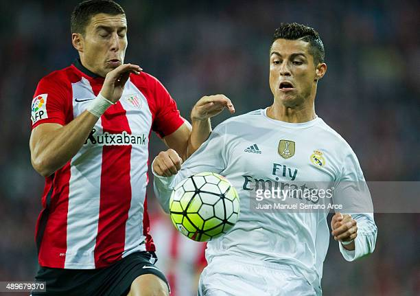 Cristiano Ronaldo of Real Madrid CF duels for the ball with Oscar De Marcos of Athletic Club Bilbao during the La Liga match between Athletic Club...
