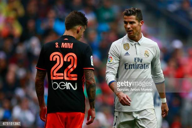 Cristiano Ronaldo of Real Madrid CF exchange looks with Santi Mina of Valencia CF during the La Liga match between Real Madrid CF and Valencia CF at...