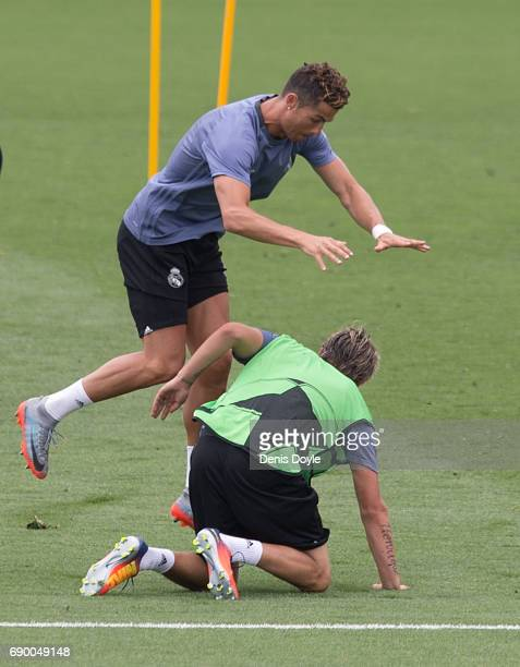 Cristiano Ronaldo of Real Madrid CF falls over his teammate Fabio Coentrao during training at the Real Madrid UEFA Open Media Day at Valdebebas...