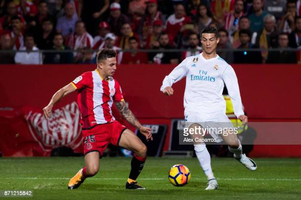 Cristiano Ronaldo of Real Madrid CF fights for the ball with Pablo Maffeo of Girona FC during the La Liga match between Girona and Real Madrid at...