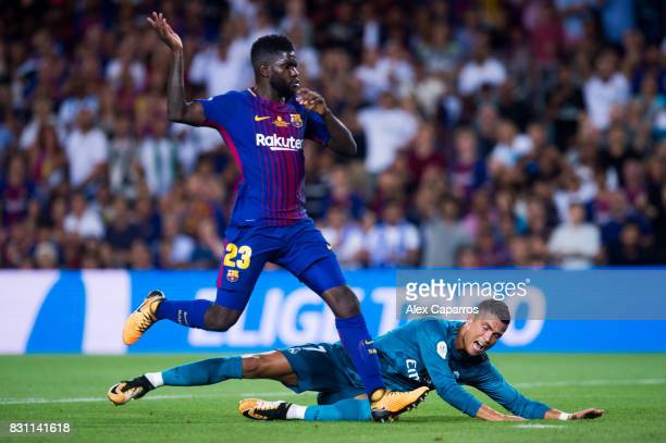 Cristiano Ronaldo of Real Madrid CF fights for the ball with Samuel Umtiti of FC Barcelona during the Supercopa de Espana Supercopa Final 1st Leg...