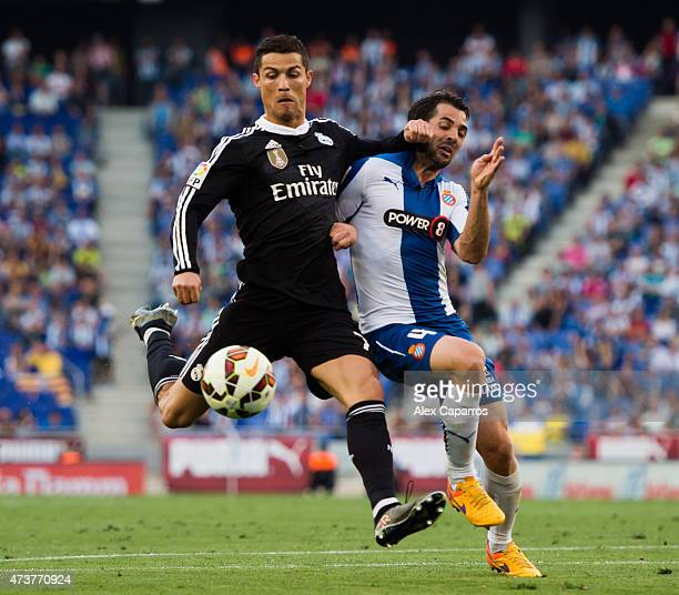 Cristiano Ronaldo of Real Madrid CF fights for the ball with Victor Sanchez of RCD Espanyol during the La Liga match between RCD Espanyol and Real...