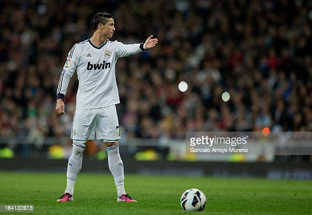 Cristiano Ronaldo of Real Madrid CF gives instructions to his teammates before taking a free kick during the La Liga match between Real Madrid CF and...