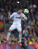 Cristiano Ronaldo of Real Madrid CF heads the ball during the Copa del Rey semi final first leg match between Real Madrid CF and FC Barcelona at...