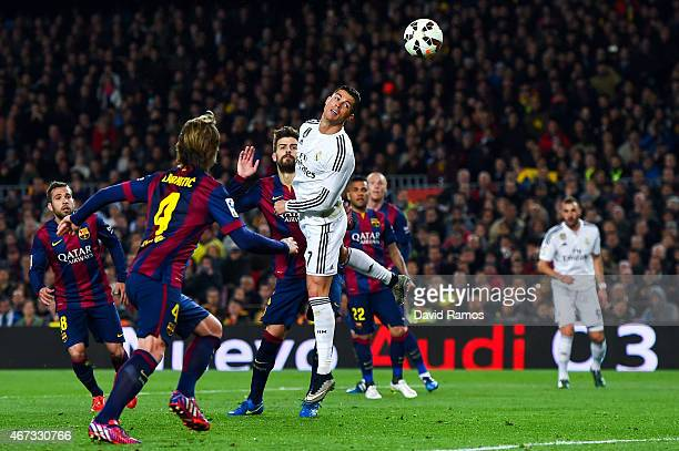 Cristiano Ronaldo of Real Madrid CF heads the ball towards goal during the La Liga match Between FC Barcelona and Real Madrid CF at Camp Nou on March...
