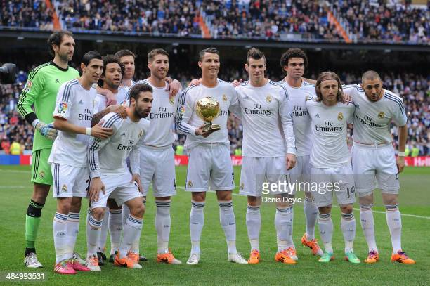 Cristiano Ronaldo of Real Madrid CF holds the Ballon d'Or 2013 award with team mates prior to he start of the La Liga match between Real Madrid CF...