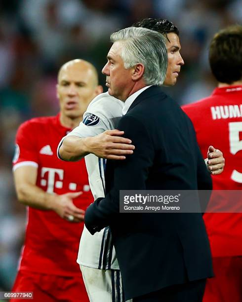 Cristiano Ronaldo of Real Madrid CF hugs head coach Carlo Ancelotti of Bayern Muenchen after the UEFA Champions League Quarter Final second leg match...