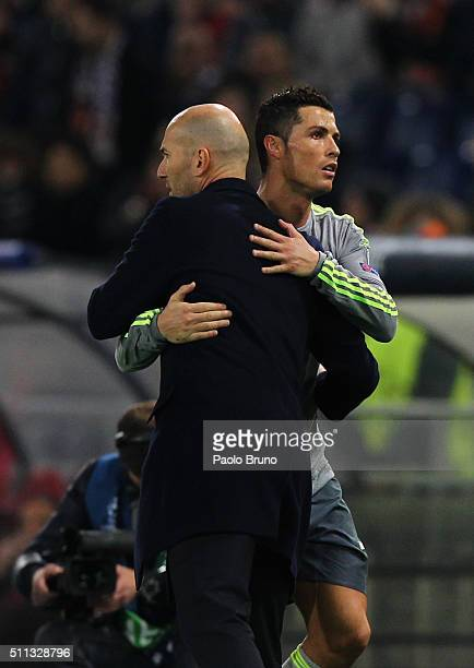 Cristiano Ronaldo of Real Madrid CF hugs his head coach Zinedine Zidane during the UEFA Champions League round of 16 first leg match between AS Roma...