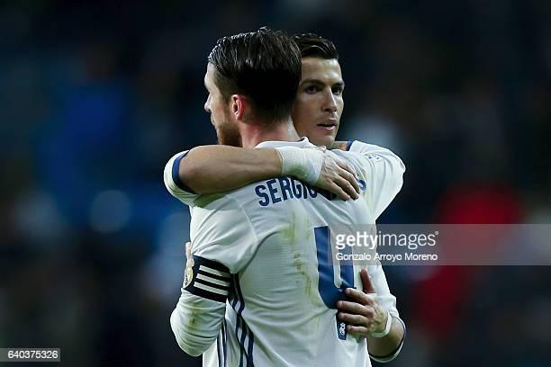 Cristiano Ronaldo of Real Madrid CF hugs his teammate Sergio Ramos after the La Liga match between Real Madrid CF and Real Sociedad de Futbol at...