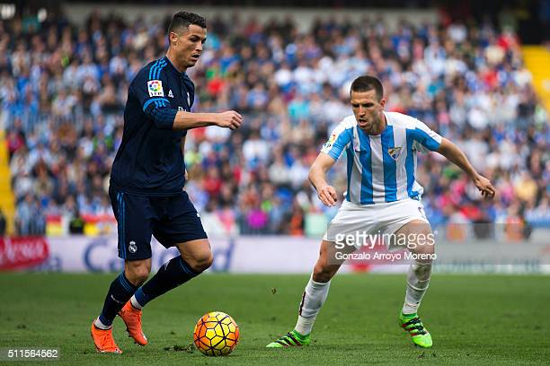 Cristiano Ronaldo of Real Madrid CF Ignacio Camacho of Malaga CF during the La Liga match between Malaga CF and Real Madrid CF at La Rosaleda Stadium...