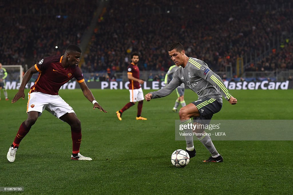 Cristiano Ronaldo (R) of Real Madrid CF in action against Antonio Rudiger of AS Roma during the UEFA Champions League Round of 16 First Leg match between AS Roma and Real Madrid CF at Stadio Olimpico on February 17, 2016 in Rome, Italy.