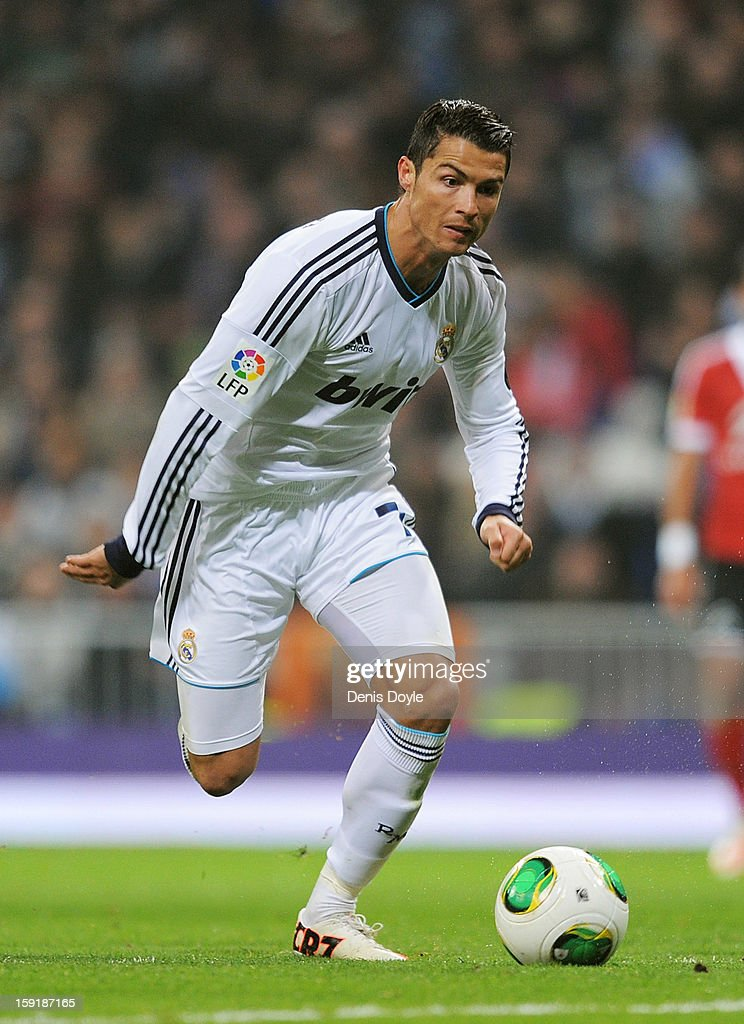<a gi-track='captionPersonalityLinkClicked' href=/galleries/search?phrase=Cristiano+Ronaldo+-+Fotbollsspelare&family=editorial&specificpeople=162689 ng-click='$event.stopPropagation()'>Cristiano Ronaldo</a> of Real Madrid CF in action during the Copa del Rey round of 16 second leg match between Real Madrid and Celta de Vigo at Estadio Santiago Bernabeu on January 9, 2013 in Madrid, Spain.