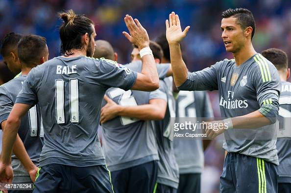 Cristiano Ronaldo of Real Madrid CF is congratulated by his teammate Gareth Bale after scoring his team's sixth goal during the La Liga match between...