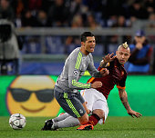 Cristiano Ronaldo of Real Madrid CF is fauled by Radja Nainggolan of AS Roma during the UEFA Champions League round of 16 first leg match between AS...