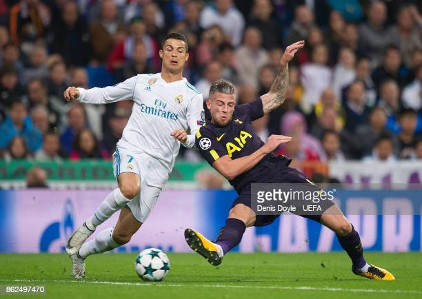 Cristiano Ronaldo of Real Madrid CF is tackled by Toby Alderweireld of Tottenham Hotspur during the UEFA Champions League group H match between Real...