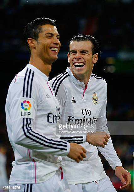 Cristiano Ronaldo of Real Madrid CF joke swith his teammate Gareth Bale prior to start the La Liga match between Real Madrid CF and Rayo Vallecano de...