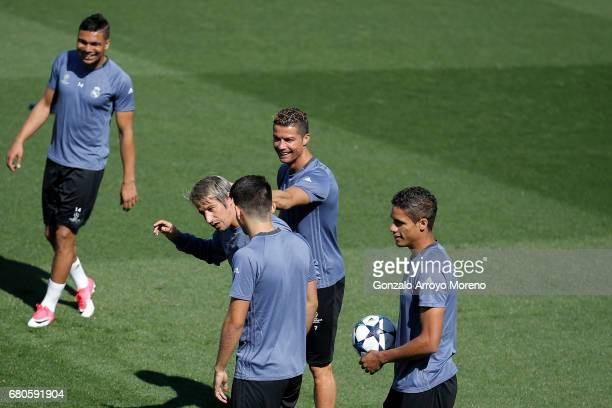 Cristiano Ronaldo of Real Madrid CF jokes with his teammate Fabio Coentrao a training session ahead of the UEFA Champions League Semifinal Second leg...