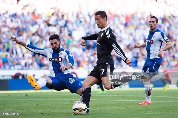 Cristiano Ronaldo of Real Madrid CF kicks the ball next to Alvaro Gonzalez of RCD Espanyol during the La Liga match between RCD Espanyol and Real...