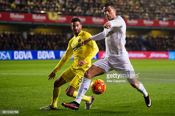 Cristiano Ronaldo of Real Madrid CF kicks the ball next to Mateo Pablo Musacchio of Villarreal CF during the La Liga match between Villarreal CF and...