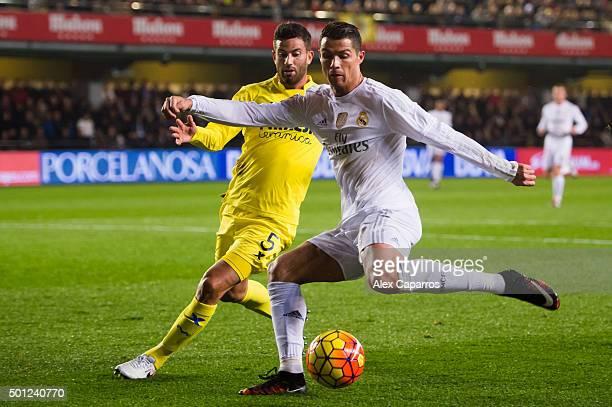 Cristiano Ronaldo of Real Madrid CF kicks the ball next to Mateo Pablo Musacchio of Villarreal CF during the La Liga match between Villarreal CF and...