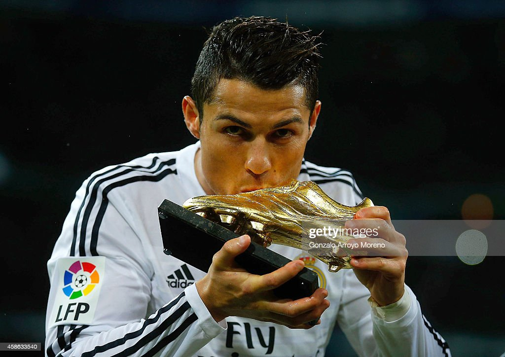 <a gi-track='captionPersonalityLinkClicked' href=/galleries/search?phrase=Cristiano+Ronaldo&family=editorial&specificpeople=162689 ng-click='$event.stopPropagation()'>Cristiano Ronaldo</a> of Real Madrid CF kisses his third Golden Boot award as best European scorer prior to start the La Liga match between Real Madrid CF and Rayo Vallecano de Madrid at Estadio Santiago Bernabeu on November 8, 2014 in Madrid, Spain.