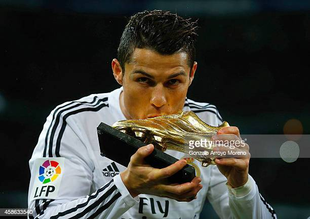 Cristiano Ronaldo of Real Madrid CF kisses his third Golden Boot award as best European scorer prior to start the La Liga match between Real Madrid...