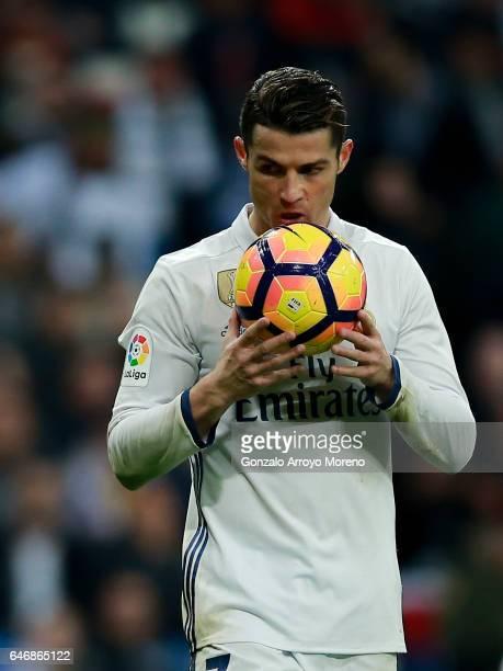 Cristiano Ronaldo of Real Madrid CF kisses the ball before shooting a penalty shot during the La Liga match between Real Madrid CF and UD Las Palmas...